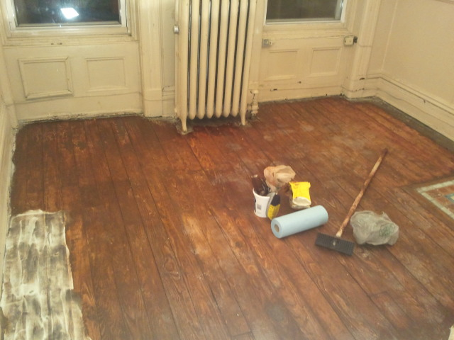 Most of the paint gone. Woo hoo! - Old Wood Floors A Pink Brownstone In Brooklyn